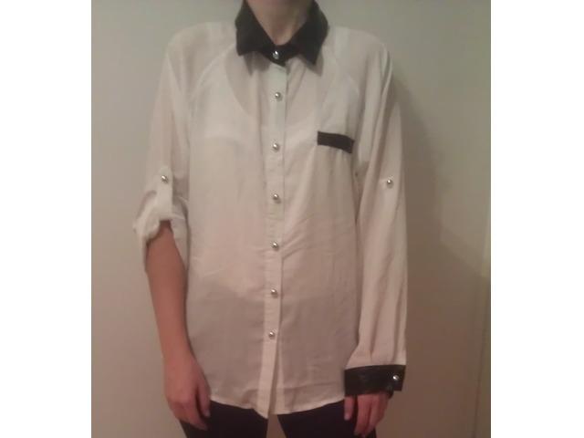 bijela košulja sa kožnim dodatkom