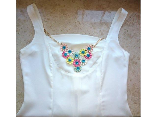 NOVA Peplum bijela bluzica